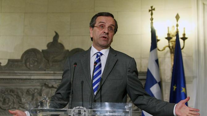 "Greece's Prime Minister Antonis Samaras attends a news conference with his Irish counterpart Enda Kenny, unseen, after their meeting at Maximos Mansion in Athens, Thursday, May 23, 2013. Samaras said that Greece would follow the ""same successful model"" as Ireland both of the EU presidency and to exit the crisis. Ireland's EU presidency will finish in the end of June. Greece is scheduled to take over the EU's rotating six-month presidency in January 2014. (AP Photo/Thanassis Stavrakis)"