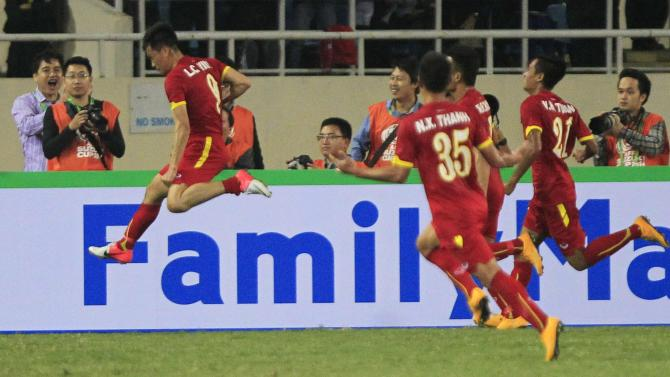 Vietnam's Le Cong Vinh celebrates after scoring a goal during their Suzuki Cup soccer match against Indonesia at My Dinh stadium in Hanoi
