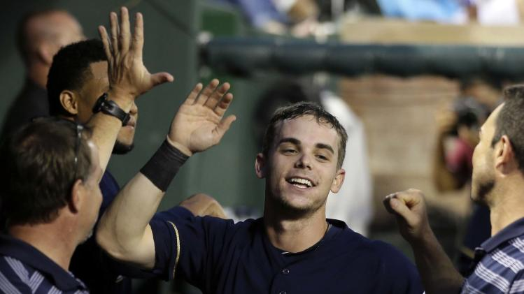 Brewers' 5-1 win snaps Texas streak