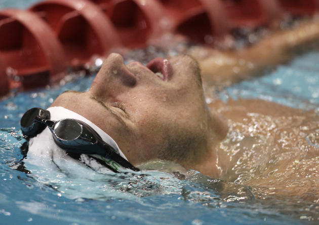 Ryan Lochte reacts after winning the men's 200-meter backstroke at the USA Swimming Grand Prix swim meet in Indianapolis, Saturday, March 5, 2011. Lochte won the event with a time of 1:57.63. (AP Phot