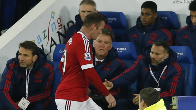 Wayne Rooney with Manchester United manager Louis van Gaal and assistant manager Ryan Giggs after he was substituted