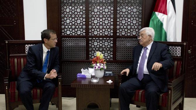 Palestinian President Mahmoud Abbas, right, meets with Israeli Zionist Union party leader Isaac Herzog, at the president's office in the West Bank city of Ramallah, Tuesday, Aug. 18, 2015. (AP Photo/Nasser Nasser)