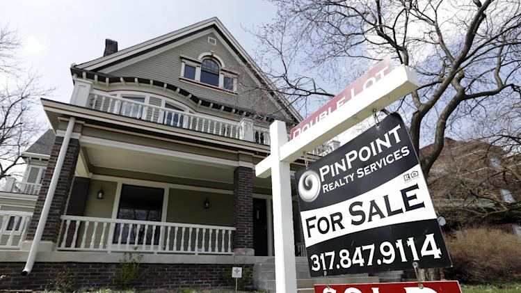 "In this Tuesday, April 9, 2013, photo, a ""Sold"" sign is posted outside a home in Indianapolis. Freddie Mac reports on mortgage rates for this week on Thursday, May 2, 2013. The average on the 30-year fixed mortgage fell last week to 3.40 percent. . (AP Photo/Michael Conroy)"