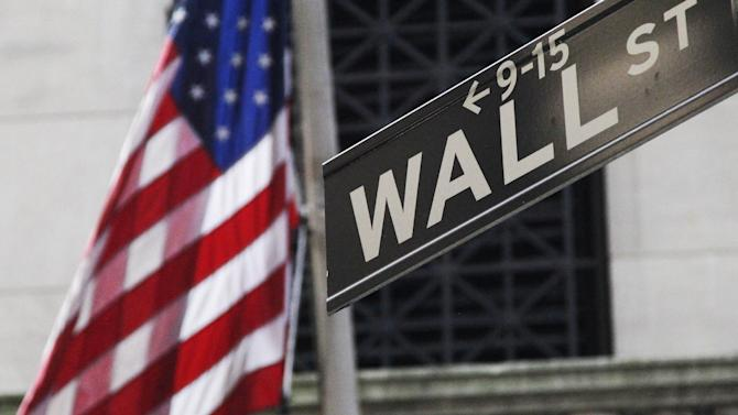 FILE - This Monday, July 15, 2013 file photo shows the American flag and Wall St. street sign outside the New York Stock Exchange, in New York. Asian stocks slumped Friday, June 27, 2014, after a reports showed weak U.S. consumer spending and slowing Chinese industrial profit growth, casting doubts on whether the world's two biggest economies can rebound. (AP Photo/Mark Lennihan, File)