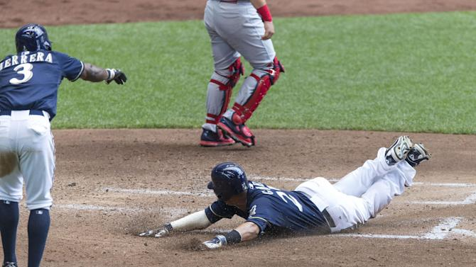 Herrera, Brewers snap 7-game skid, rout Cardinals