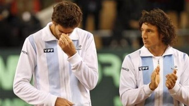 Argentina's Juan Martin del Potro, left, and Juan Monaco, react during the Davis Cup ceremony in Seville, Spain, Sunday, Dec. 4, 2011. Spain's Rafael Nadal got the winning point as Spain won a fifth Davis Cup