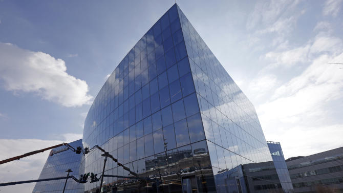 In this Wednesday, Feb. 6, 2013 photo, shown is the new GlaxoSmithKline building at the Navy Yard in Philadelphia. The city's Navy Yard is celebrating a milestone that skeptics might not have believed 15 years ago. Nearly all naval operations are long gone from the sprawling former shipyard but 10,000 people now work there in an eclectic mix of businesses from fashion to pharmacies. That number is expected to triple in 20 years. (AP Photo/Matt Rourke)