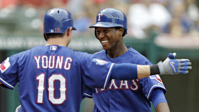 Texas Rangers' Jurickson Profar, right, is greeted by Michael Young (10) after a solo home run off Cleveland Indians starting pitcher Zach McAllister in the third inning of a baseball game on Sunday, Sept. 2, 2012, in Cleveland. Profar hit the home run in his first major league at-bat. (AP Photo/Mark Duncan)