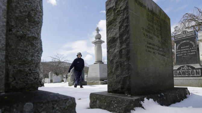 Kathleen Silvia, director of the West Point Cemetery, walks in the cemetery on Friday, March 22, 2013, in West Point, N.Y. Graves of soldiers from every U.S. war make this small plot of the land the most hallowed ground on the nation's the most venerable military academy. And after 196 years and more than 8,000 souls, it's close to full. (AP Photo/Mike Groll)