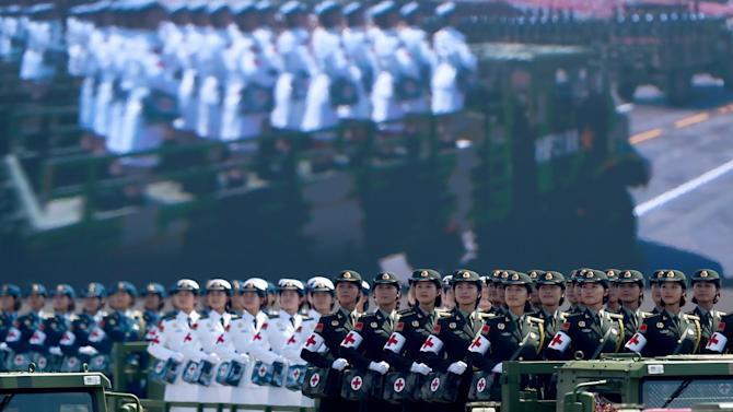 Chinese People's Liberation Army personnel participate in a military parade at Tiananmen Square in Beijing