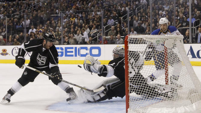 Los Angeles Kings goalie Jonathan Quick, center, stops a shot as Kings' Rob Scuderi, left, and St. Louis Blues' Chris Stewart watch during the third period in Game 3 of a first-round NHL hockey Stanley Cup playoff series in Los Angeles, Saturday, May 4, 2013. The Kings won 1-0. (AP Photo/Jae C. Hong)