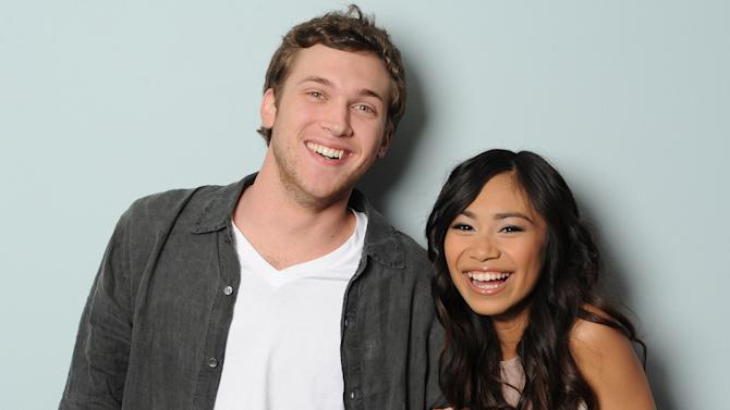 This image provided by FOX-TV shows American Idol finalists Phillip Phillips, left and Jessica Sanchez taken May 17, 2012. The booming 20-year-old vocal powerhouse from Westlake, La., was revealed Thursday to have received the fewest viewer votes on the Fox talent contest, leaving bluesy 21-year-old crooner Phillip Phillips of Leesburg, Ga., and sassy 16-year-old budding diva Jessica Sanchez of San Diego, to compete for the show's record deal grand prize on next week's finale. (AP Photo/Michael Becker, FOX)