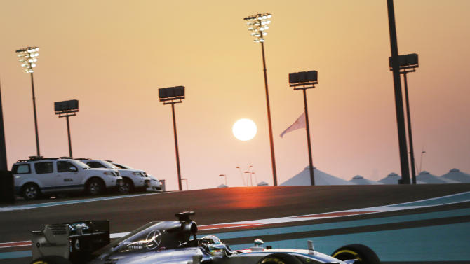 Mercedes driver Lewis Hamilton of Britain steers his car during the second free practice at the Yas Marina racetrack in Abu Dhabi, United Arab Emirates, Friday, Nov. 21, 2014. The Emirates Formula One Grand Prix will take place on Sunday. (AP Photo/Hassan Ammar)
