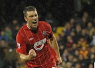 Southampton striker Rickie Lambert scores a penalty in the Premier League match against Fulham at Craven Cottage on December 26, 2012. Manchester United manager Alex Ferguson wants his players to replicate Lambert's impeccable record from the spot
