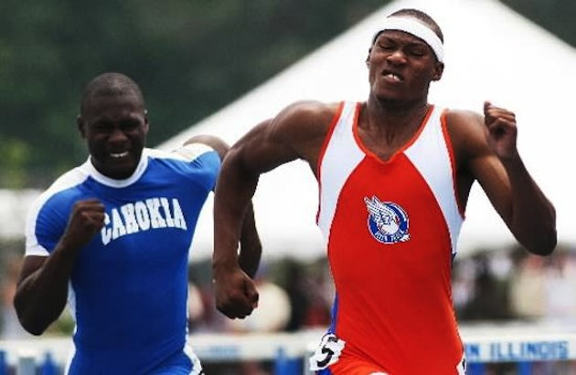 The Cahokia track team, rear, may be no longer in 2014 — AP