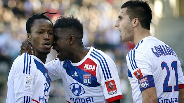 FRANCE, Lyon : Lyon's Burkinabe defender Bakary Kone (L) is congratulated by teammates after scoring a goal during the French L1 football match Olympique Lyonnais (OL) vs Toulouse Football Club (TFC) on April 14, 2013 (AFP)