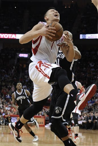 Harden, Asik lead Rockets past Nets