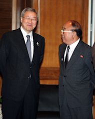 North Korean Foreign Minister Pak Ui Chun, right, talks to South Korean counterpart Kim Sung-hwan at the 18th ASEAN Regional Forum in Nusa Dua, Bali, Indonesia, Saturday, July 23, 2011. (AP Photo/Firdia Lisnawati)