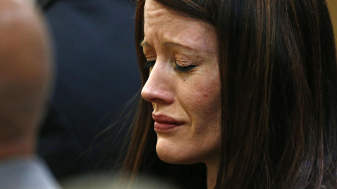 Tanisha Sorenso closes her eyes as autopsy photos of her brother Travis Alexander are displayed on Wednesday, May 15, 2013 during the sentencing phase of the Jodi Arias murder trial at Maricopa County Superior Court in Phoenix. If the jury finds aggravating factors in her crime, Arias could be sentenced to death. Jodi Arias was convicted of first-degree murder in the stabbing and shooting to death of Travis Alexander, 30, in his suburban Phoenix home in June 2008. (AP Photo/The Arizona Republic, Rob Schumacher, Pool)
