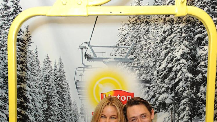 IMAGE DISTRIBUTED FOR LIPTON: Costars Jennifer Coolidge and JJ Field enjoy a hot cup of tea and a laugh at the Lipton Uplift Lounge during Sundance on Sunday Jan. 20, 2013, in Park City, UT. (Photo by Jordan Strauss/Invision for Lipton/AP Images)