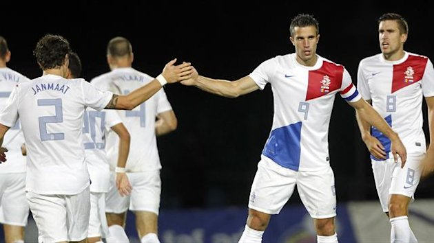 Netherlands' Robin Van Persie (9) celebrates with teammate Darryl Janmaat after scoring a goal against Andorra (Reuters)
