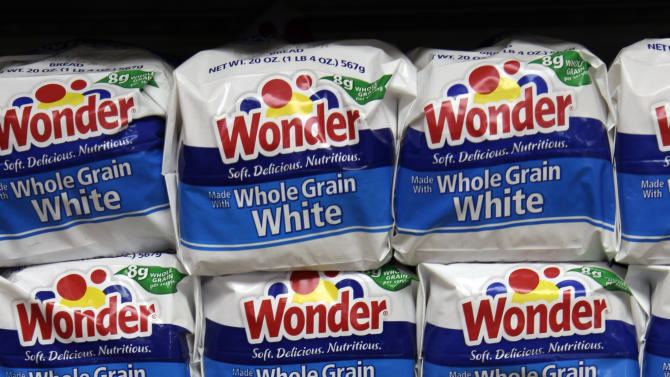 FILE- In this Wednesday, Jan. 11, 2012, file photo, Hostess Brands Wonder breads are displayed at a grocery store in Santa Clara, Calif. A person familiar with the situation says a bid by Flowers Foods to buy Wonder and several other bread brands from Hostess was met with no competing offers on Tuesday, Feb. 27, 2013. The individual requested anonymity because the auction process is private. (AP Photo/Paul Sakuma, File)