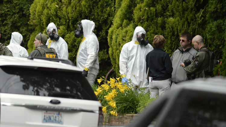 FILE - In this May 18, 2013 file photo, members of the Joint Federal Haz-Mat Team, FBI, and local law enforcement gather in front of the Osmun Apartments near the intersection of First Avenue and Oak Street in Browne's Addition during the execution of a search warrant, in Spokane, Wash., in connection with ricin-laced letters intercepted at a Post Office facility in Spokane earlier in the week.  Over the past month and a half, the FBI has investigated at least three apparently unrelated cases of ricin-laced letters sent to President Barack Obama and other public figures. It's not clear if ricin attacks are on the rise. Experts say some of the recent letters are no doubt copycat attacks, made possible by the relative simplicity of making the poison. (AP Photo/The Spokesman-Review, Colin Mulvany) COEUR D'ALENE PRESS OUT