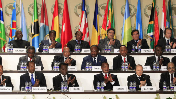 African heads of state and country representatives applaud the president of South Sudan, unseen, during the opening session of the 17th African Union Summit, at the Sipopo Conference Center outside Malabo, Equatorial Guinea, Thursday, June 30, 2011. Foreign military intervention has caused massive suffering in Africa and should only be carried out with the consensus of African nations, Equatorial Guinea President Teodoro Obiang Nguema said Thursday at the opening of the body's biannual summit. (AP Photo/Rebecca Blackwell)