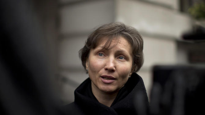 FILE - In this Thursday, Dec. 13, 2012 file photo, Marina Litvinenko, the widow of former Russian intelligence officer Alexander Litvinenko, speaks to the media as she leaves at the end of a pre-inquest review at Camden Town Hall in London. More than eight years on and with the U.K.-Russia relations at their iciest since the Cold War, an inquiry is opening on Tuesday, Jan. 27, 2015 into the killing of the Russian intelligence agent turned Kremlin critic. (AP Photo/Matt Dunham, File)