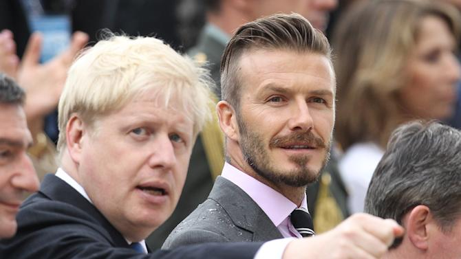 Former England football captain David Beckham, right, and London Mayor Boris Johnson attend a handover for the Olympic flame at Panathenaean stadium in Athens, Thursday, May 17, 2012.  The torch begins its 70-day journey to arrive at the opening ceremony of the London 2012 Olympics, from the Greek capital, to cover about 8,000-mile (12,875-kilometer) on its progress over many parts of England to start the games.  (AP Photo/Thanassis Stavrakis)