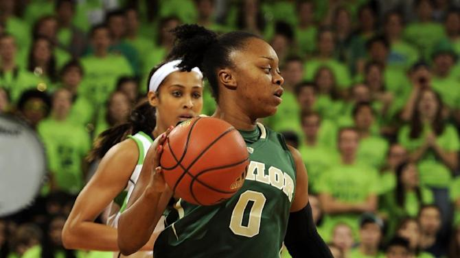 Baylor guard Odyssey Sims, right, drives upcourt as Notre Dame guard Skylar Diggins gives chase during the first half of an NCAA college basketball game on Wednesday, Dec. 5, 2012 in South Bend, Ind. (AP Photo/Joe Raymond)