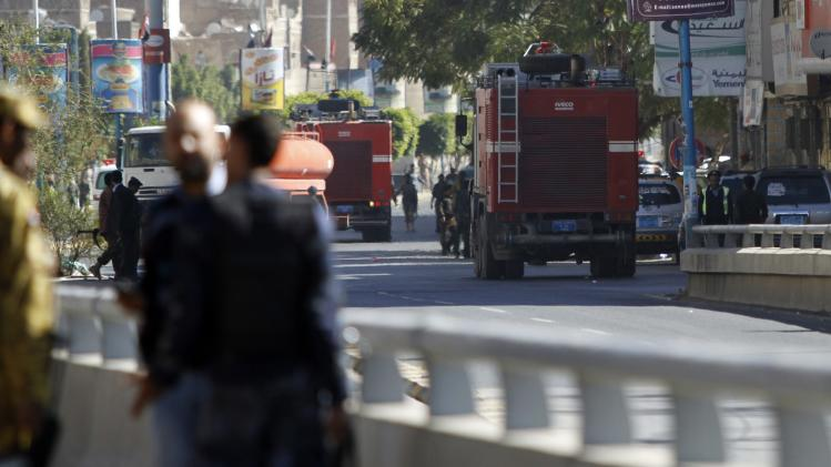Firefighter trucks drive to the Defence Ministry's compound after an attack in Sanaa