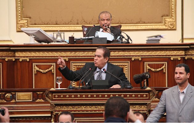 FILE - In this Feb. 2, 2012 file photo, Saad el-Katatni, a lawmaker from the Muslim Brotherhood and newly nominated Parliament Speaker, top center, and Prime Minister Kamal el-Ganzouri attend an emerg