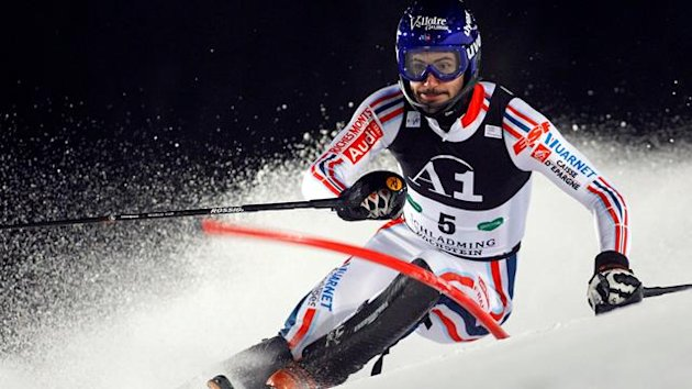 Jean-Baptiste Grange of France passes a gate during the first run of the men's slalom race at the Alpine Skiing World Cup in Schladming