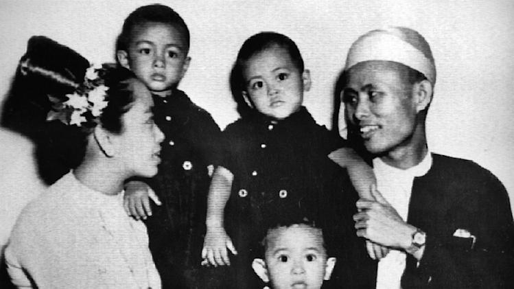 "FILE - In this 1947 file photo, then two-year-old Aung San Suu Kyi, center, sits for a portrait with her parents and two elder brothers in Myanmar. President Barack Obama's historic visit to Myanmar on Monday, Nov. 19, 2012 is meant to show America's support for the country's transition to democracy. The White House has cautioned that Obama's trip to the former pariah state should not be viewed as a ""victory celebration"" but as an opportunity to press for urgent action still needed in Myanmar. Notably, freeing political prisoners and ending ethnic tension in remote areas.  (AP Photo/Kyodo News, File) JAPAN OUT, MANDATORY CREDIT, NO LICENSING IN CHINA, FRANCE, HONG KONG, JAPAN AND SOUTH KOREA"