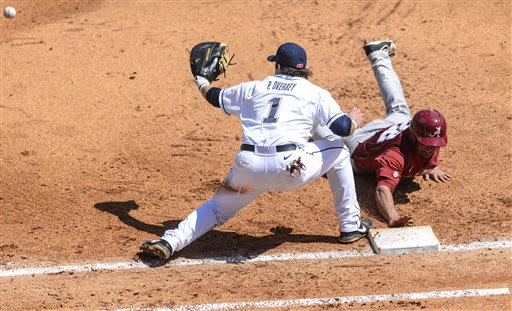 Alabama's Georgie Salem dives back to first as Mississippi's Preston Overbey takes the throw during a Southeastern Conference tournament college baseball game in Hoover, Ala., Thursday, May 23, 2013