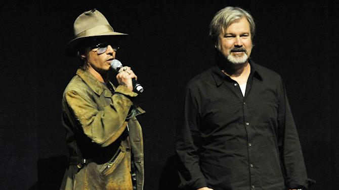 """File - In this Wednesday, April 17, 2013 file photo, Johnny Depp, left, who plays Tonto in the upcoming film """"The Lone Ranger,"""" speaks to theater owners and media as the film's director Gore Verbinski looks on during the Walt Disney Studios presentation at CinemaCon 2013 at Caesars Palace, in Las Vegas. (Photo by Chris Pizzello/Invision/AP, File)"""
