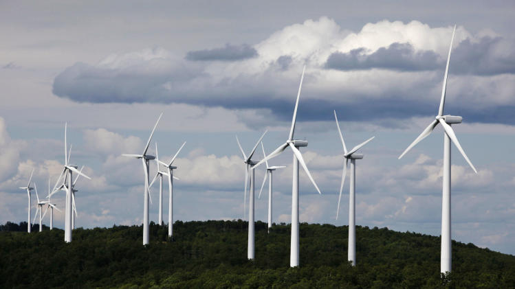 FILE - In this July 14, 2009 file photo, a cluster of windmills catch the wind blowing on Stetson Mountain, in Range 8, Township 3, Maine. A group of wind power executives, meeting in Atlanta,  says a stalled effort to renew federal tax credits for the industry is creating instability and financial concerns. Meanwhile, presidential aides Karl Rove and Robert Gibbs spoke with executives at their annual conference about bipartisan support for the tax credits but a tough political climate between now and the November presidential election. (AP Photo/Robert F. Bukaty, files)