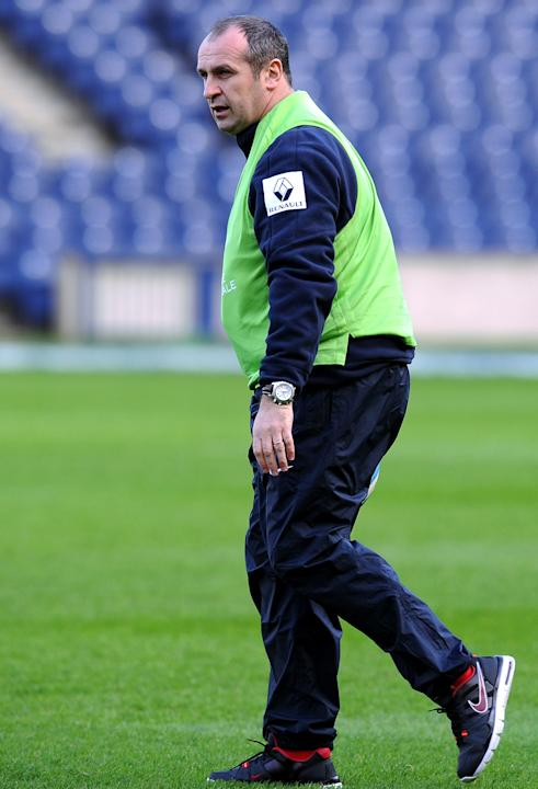 France's rugby union national team head coach Philippe St Andre looks as his players during a training session on February 25, 2012 at Murrayfield Stadium in Edinburgh, on the eve of the rugby union 6
