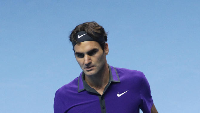 Roger Federer of Switzerland reacts to a game win against Janko Tipsarevic of Serbia, during their ATP World Tour Finals singles tennis match at the O2 Arena in London, Tuesday, Nov. 6, 2012. (AP Photo/Sang Tan)