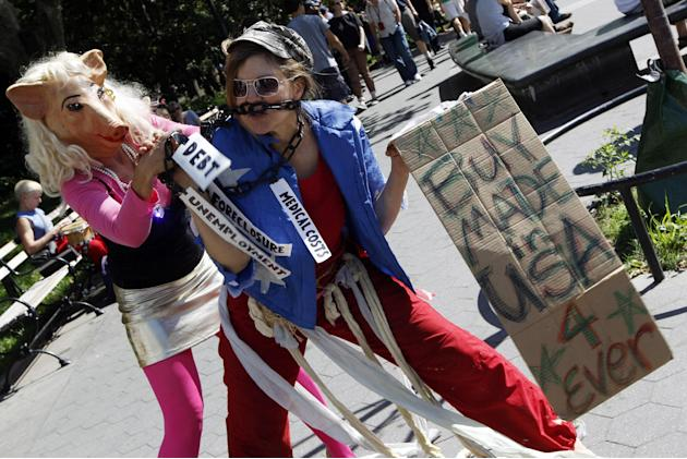 Activist associated with the Occupy Wall Street movement perform a skit during a gathering of the movement in Washington Square park, Saturday, Sept. 15, 2012 in New York. The Occupy Wall Street movem