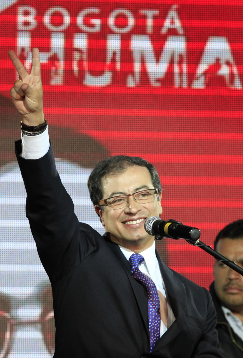 Gustavo Petro gestures to supporters as he celebrates winning Bogota's mayoral race in Bogota, Colombia, Sunday Oct. 30, 2011. Voters on Sunday elected Gustavo Petro as mayor of Bogota, the first time an ex-guerrilla has won Colombia's second most important elected office.  (AP Photo/Fernando Vergara)