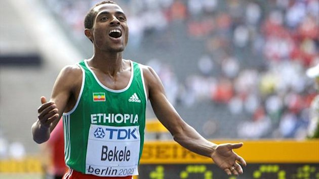 Kenenisa Bekele (R) of Ethiopia celebrates after winning the men's 5000 meters final during the world athletics championships at the Olympic stadium in Berlin, August 23, 2009