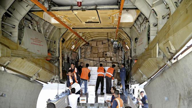 In this photo released by the Syrian official news agency SANA, a Russian plane carrying medical aid supplies is unloaded at the international airport in the Syrian capital Damascus on Saturday, October 6, 2012. The Russian government said the medicines and equipment had been approved by the Syrian Health Ministry. (AP Photo/SANA)