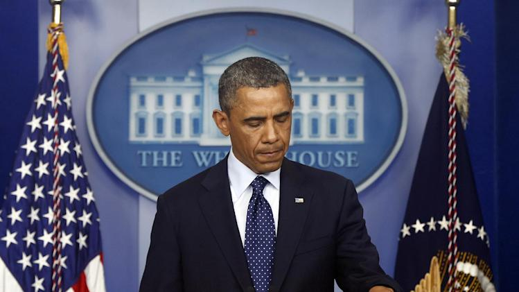 President Barack Obama pauses as he begins to speak in the James Brady Press Briefing Room at the White House in Washington, Monday, April 15, 2013, following the explosions at the Boston Marathon. (AP Photo/Charles Dharapak)