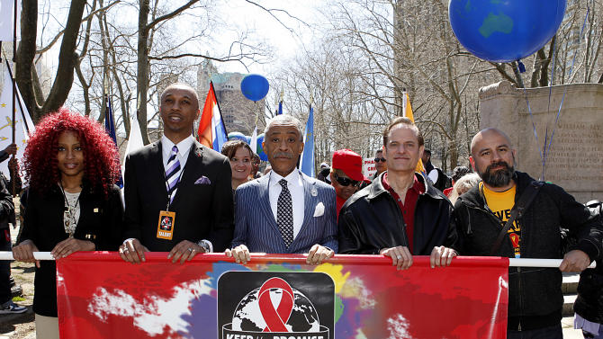 """IMAGE DISTRIBUTED FOR AIDS HEALTHCARE FOUNDATION - From left, Malina Fisher, Elder Stacey Latimer, Reverend Al Sharpton, AHF's Michael Weinstein, and Michael Camacho march during the AIDS Healthcare Foundation's """"Keep The Promise On AIDS"""" March and Rally on Saturday, April 6, 2013, in New York.  The """"Keep the Promise"""" campaign brings together advocates along with entertainers and spiritual and political leaders to remind elected officials that the fight against HIV/AIDS is not yet won.(Brian Ach /AP Images for AIDS Healthcare Foundation)"""