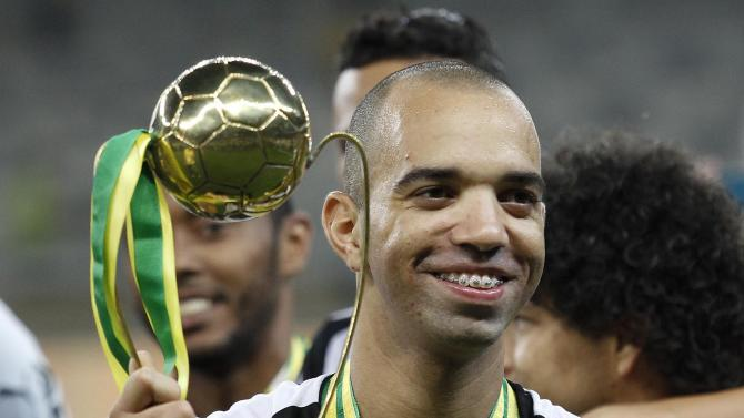 Tardelli of Atletico Mineiro celebrates with the Best Player trophy after winning the Copa do Brasil final soccer match against Cruzeiro at Mineirao stadium in Belo Horizonte