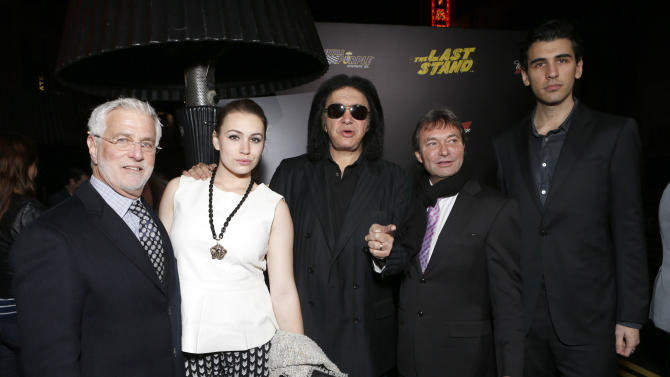 "Lionsgate Motion Picture Group co-chairman Rob Friedman, Sophie Simmons, Gene Simmons, Lionsgate Motion Picture Group co-chairman Patrick Wachsberger, and Nick Simmons attend the LA premiere of ""The Last Stand"" at Grauman's Chinese Theatre on Monday, Jan. 14, 2013, in Los Angeles. (Photo by Todd Williamson/Invision/AP)"