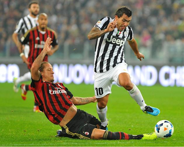 Juventus forward Carlos Tevez, of Argentina, right,  dribbles past AC Milan defender Philippe Mexes, of France, during a Serie A soccer match between Juventus and AC Milan at the Juventus stadium, in