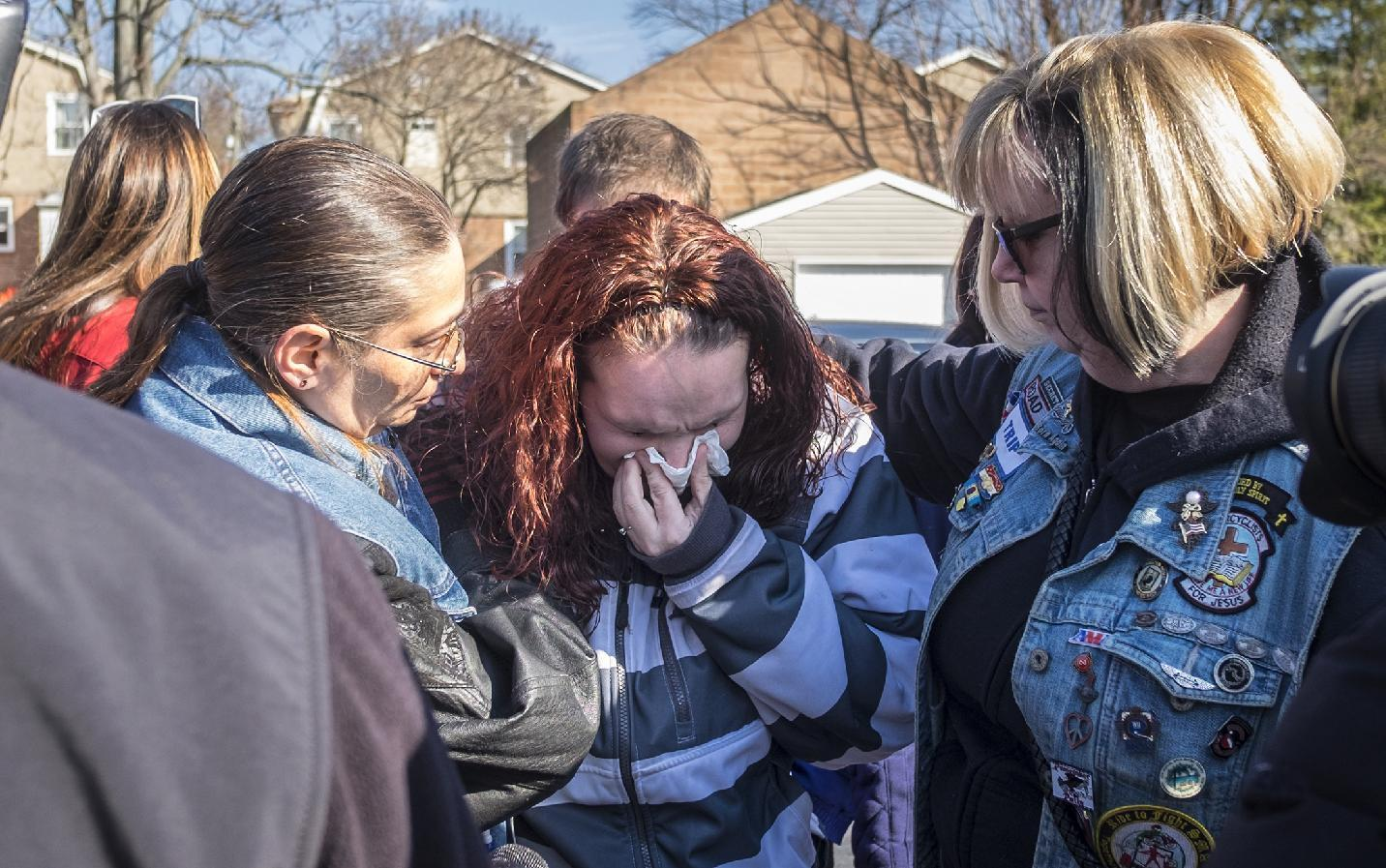The Latest: Friends: Slain teen had typical parent issues